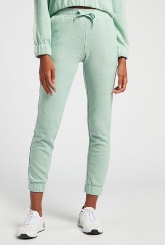 Solid Mid-Rise 3/4th Jog Pants with Pockets and Drawstring Closure