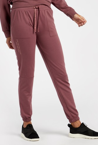Solid Mid-Rise Panelled Joggers with Drawstring Closure