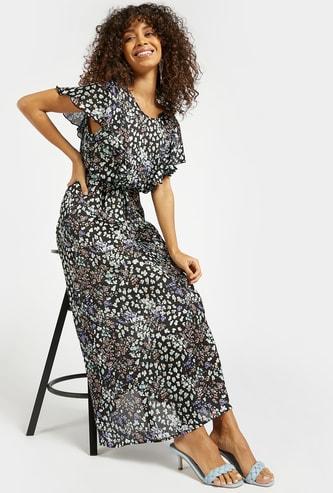 فستان طويل بطبعات الأزهار وأكمام مكشكشة