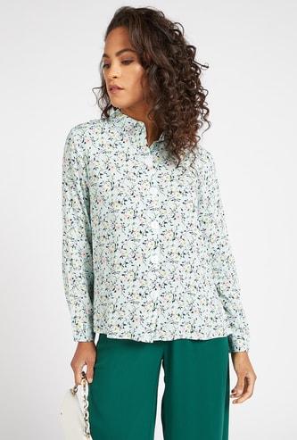 قميص بأكمام طويلة وأزرار وطبعات زهرية