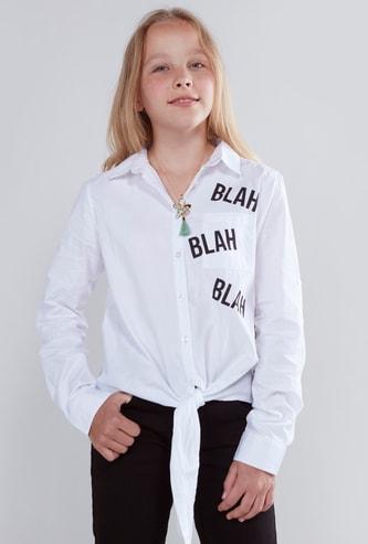 قميص بأكمام طويلة وأربطة وطبعات