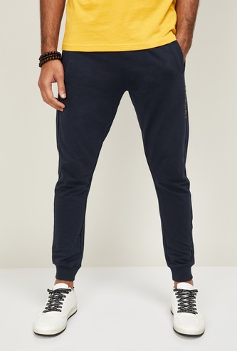FAME FOREVER Men Typographic Printed Elasticated Joggers