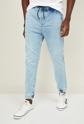 UCLA Men Stonewashed Skinny Fit Jogger Jeans