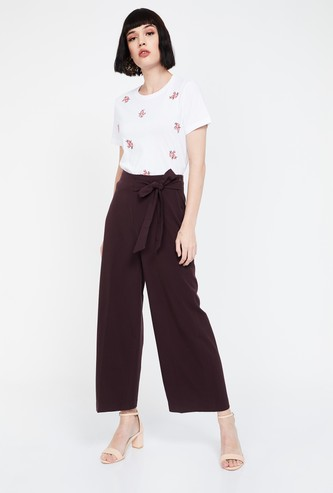 CODE Solid High-Rise Tie-Up Waist Flared Trousers