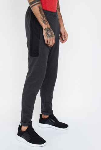 PUMA Heathered Tapered Track Pants with Mesh Overlay