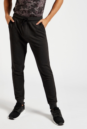 Slim Fit Solid Jog Pants with Pockets and Tape Detail