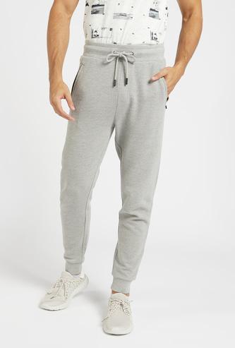 Slim Fit Textured Ottoman Mid-Rise Jog Pants with Drawstring Closure