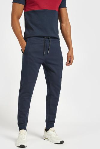 Solid Mid-Rise Jog Pants with Drawstring Closure and Pockets