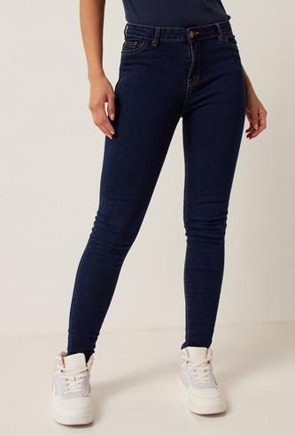 بنطلون جينز سكيني بخصر متوسط الارتفاع وزر إغلاق