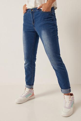 بنطلون جينز طويل سكيني بخصر متوسط الارتفاع وزر إغلاق