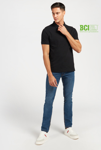 Full Length Mid-Rise Jeans with Pocket Detail and Button Closure