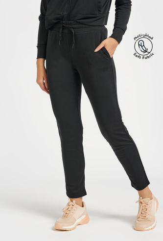 Solid Soft-Touch Mid-Rise Track Pants with Drawstring Closure and Pockets