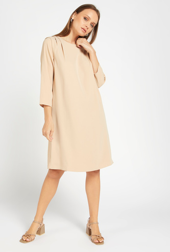 Knee Length Solid Shift Dress with Shoulder Pleat Detail