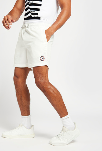 Solid Mid-Rise Shorts with Pocket Detail and Drawstring Closure