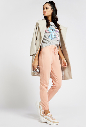 Solid Jog Pants with Print Patch Detail and Drawstring