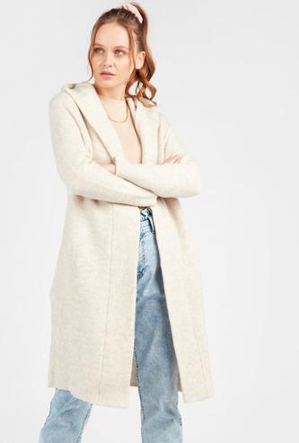 معطف ثقيل بارز الملمس بأكمام طويلة وجيوب