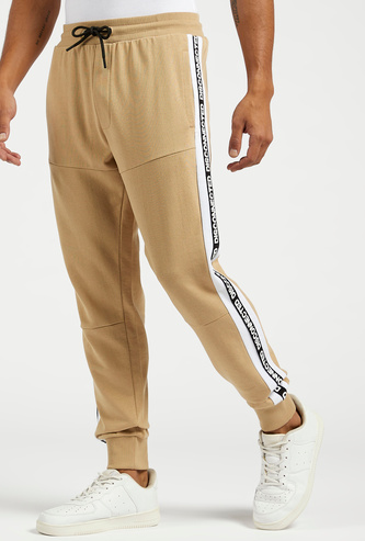 Slim Fit Jog Pants with Printed Side Tape and Pockets