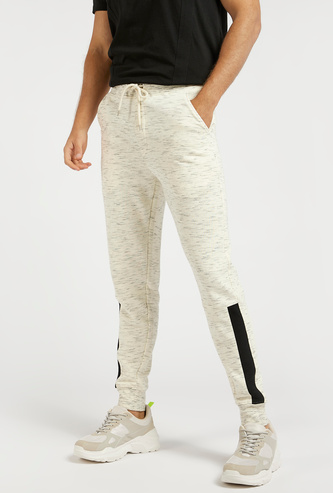 Slim Fit Injected Print Mid-Rise Jog Pants with Pocket Detail