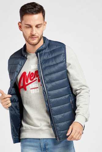 Solid Puffed Sleeveless Jacket with Zip Closure