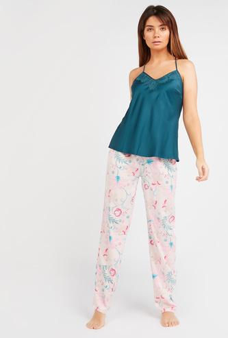 Solid Sleeveless Top and All Over Printed Pyjamas