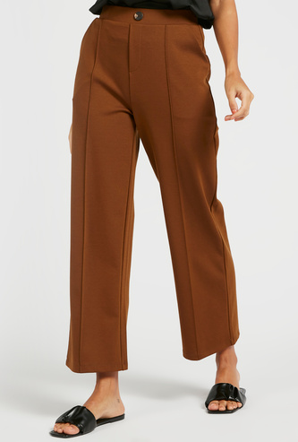 Solid Ankle Length Mid-Rise Pants with Pockets and Button Detail