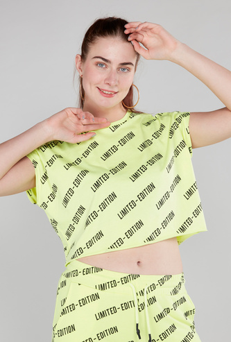 Printed Crop Top with Extended Sleeves and Round Neck
