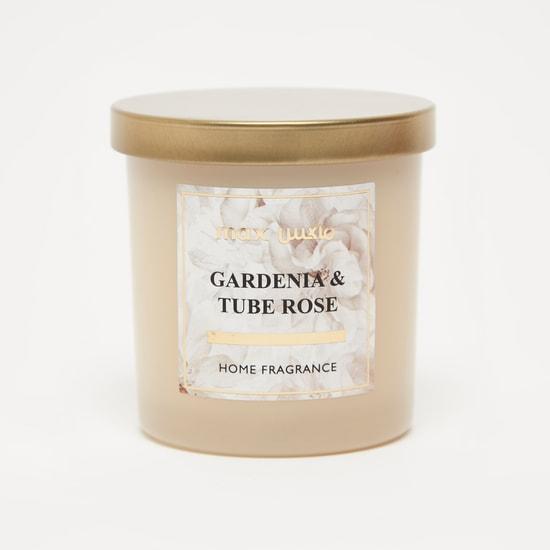 شمعة برائحة الجاردينيا وزهرة الأنبوب