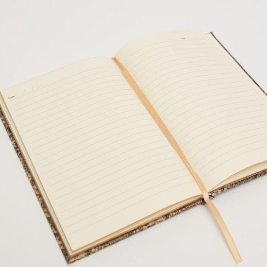 دفتر ملاحظات بسطر واحد وطبعات جلد زواحف