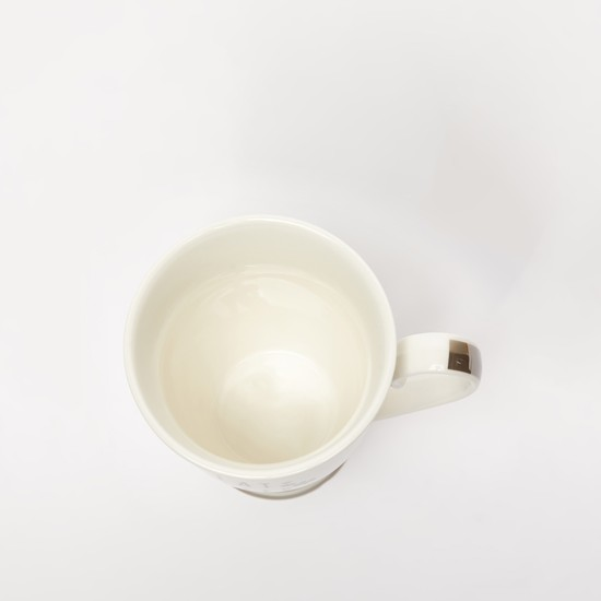 مج قهوة بطبعات ومقبض