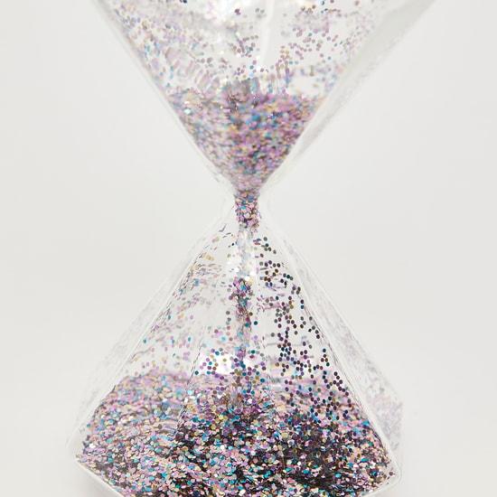 قطعة ديكور بتصميم ساعة رملية