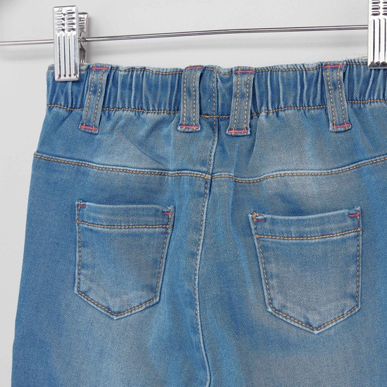 بنطلون جينز طويل بتفاصيل مطرزة  وجيوب