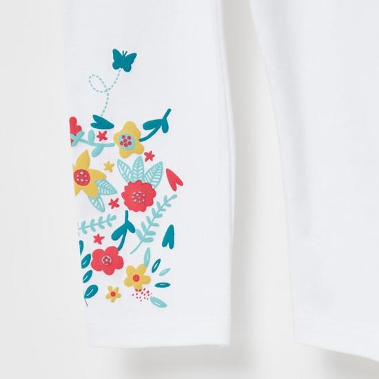 بنطلون ليقنز متوسط الارتفاع بحزام خصر مطّاطي وطبعات أزهار