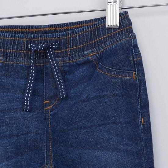 بنطال جينز طويل برباط وجيوب