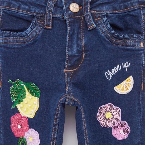 بنطلون جينز مزين بجيوب وحلقات للحزام