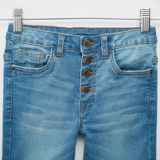 بنطلون جينز سادة بأقدام واسعة وبأزرار إغلاق وجيوب