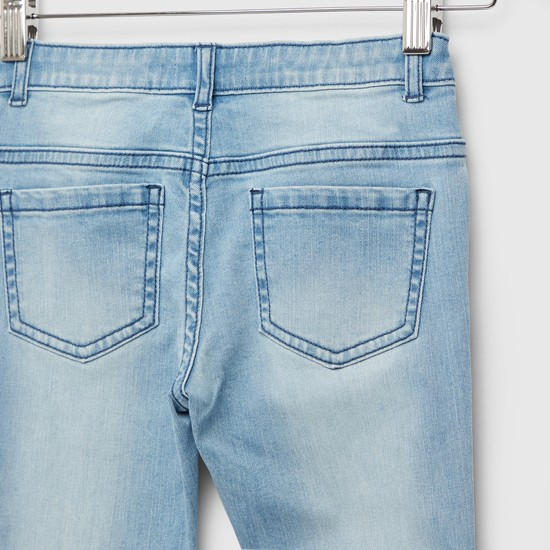 بنطلون جينز مطرز بجيوب وطبعات ديزني