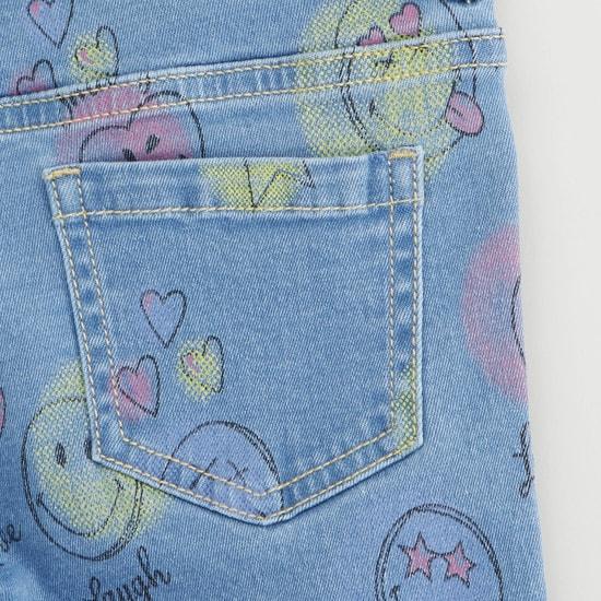 بنطلون جينز سكيني بطبعات ريموجي بزر وسحّاب إغلاق