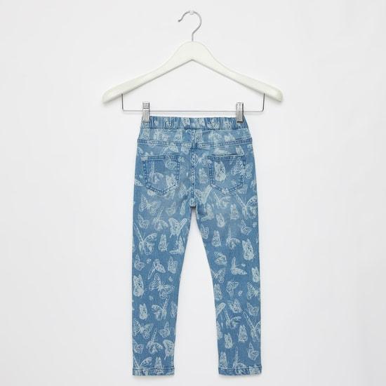 بنطلون جينز بخصر مطّاطي و جيوب وطبعات فراشة