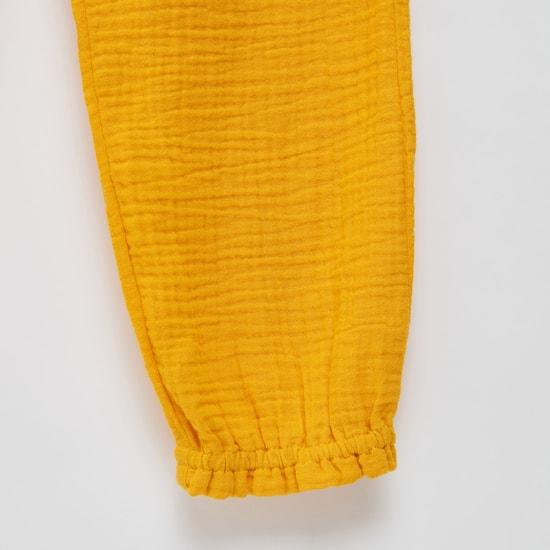 بنطلون رياضي بارز الملمس بفيونكة جانبية وحزام خصر مطاطي