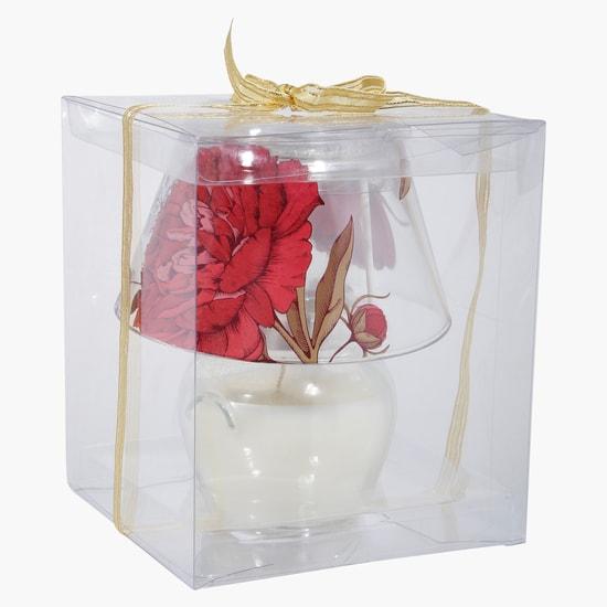 شموع زينة في وعاء بطبعات الأزهار