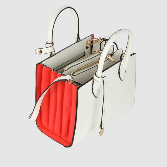 حقيبة يد بسحّاب للإغلاق