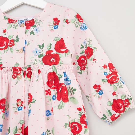 فستان بياقة مستديرة وأكمام طويلة وطبعات أزهار