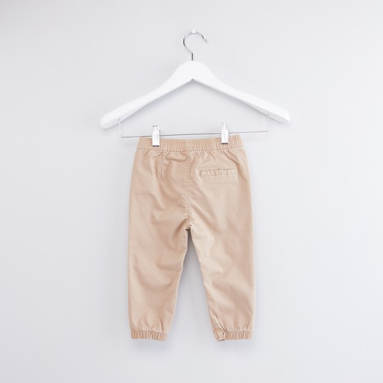 Solid Jogger Pants with Elasticated Waistband and Stitch Detail