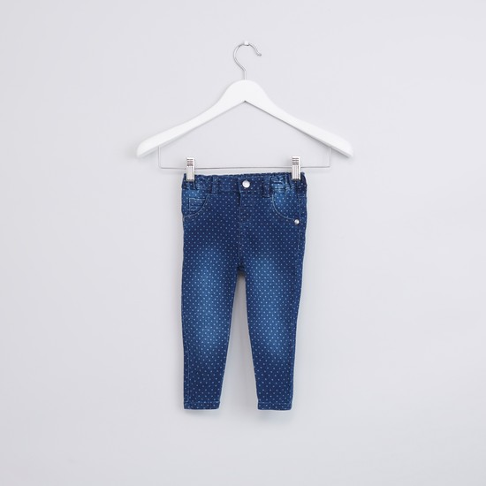بنطال جينز بزر إغلاق وجيوب وطبعات منقّطة