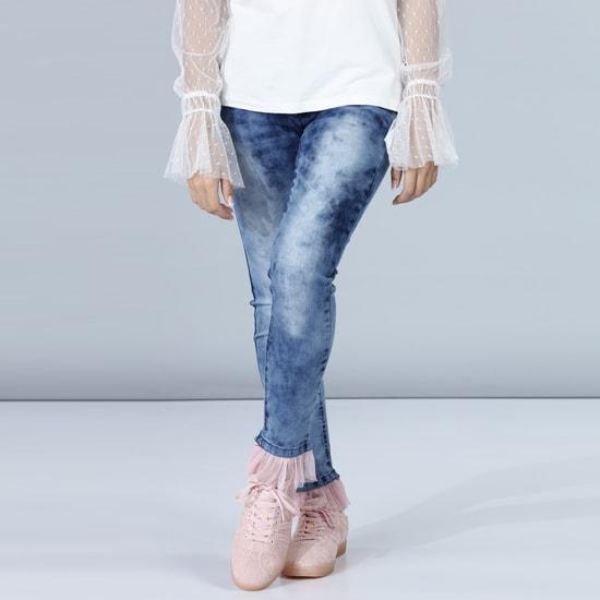 بنطال جينز طويل بتصميم باهت