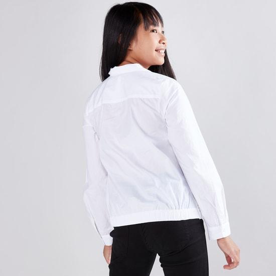 قميص مزيّن بأكمام طويلة