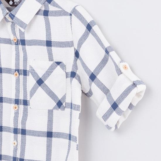 قميص كاروهات بأكمام طويلة وجيوب