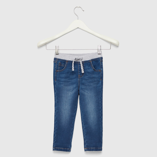 بنطلون جينز كامل الطول ومطابق للجسم برباط خصر مطاطي