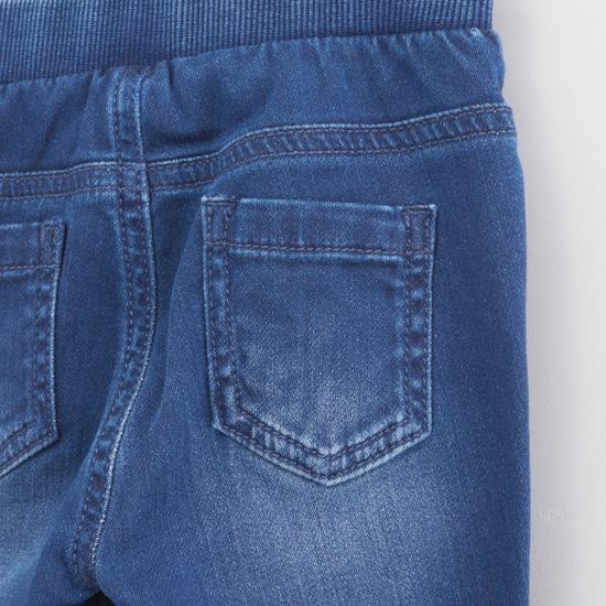 بِنطال جينز طويل مُطرّز بجيوب