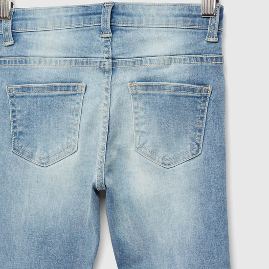 بنطلون جينز بتفاصيل جيوب وطبعات لوني تيونز